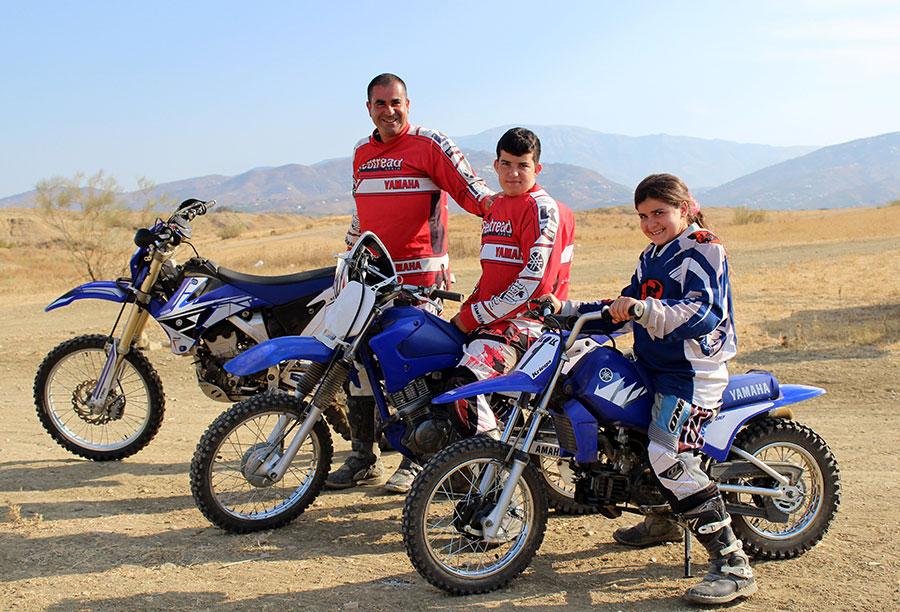 A Family on a one day off road motorcycle tour in Spain.