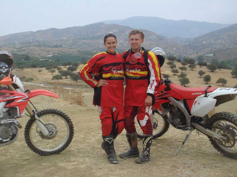A Couple posing for a photo during an off road motorcycle tour, adventures with Redtread