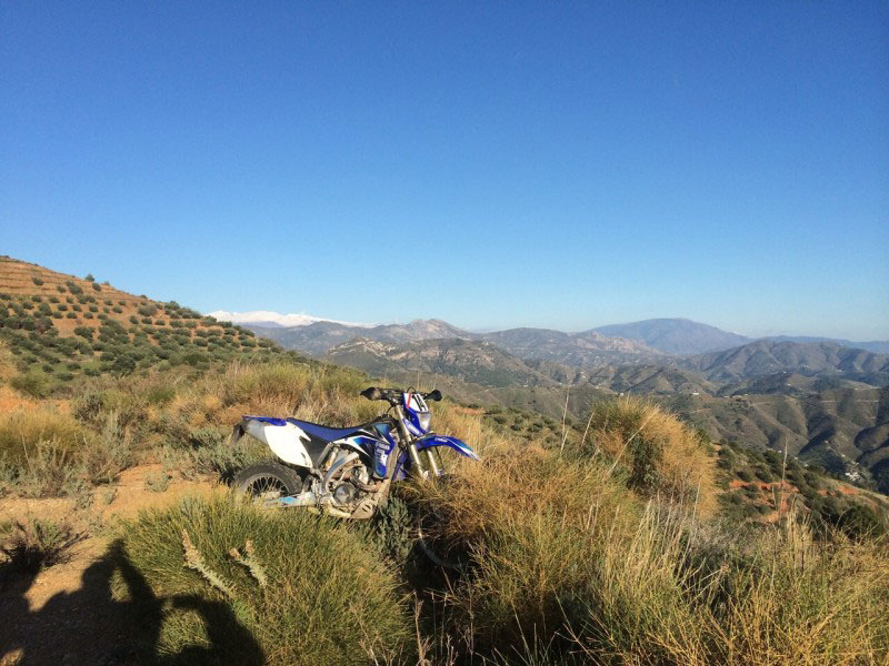 Off road motorbike with picturesque view of Southern Spain. Off road motorcycle tour organised by Redtread