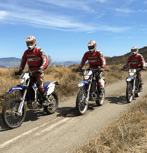 Three offroad bikers on the move during a Long Weekend off road motorcycle tour in Spain with Redtread