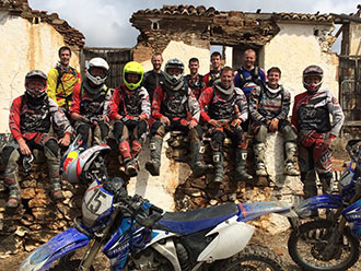 The gang stopping for a break during an off road motorcycle tour in Spain with Redtread